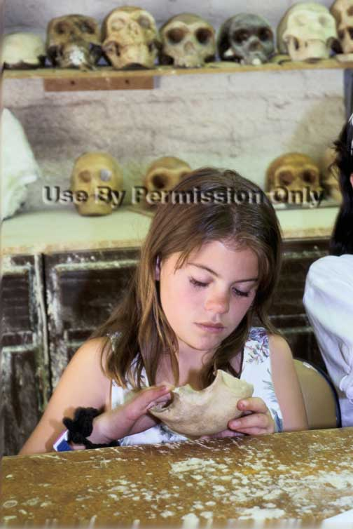 Student inspects bone fragment