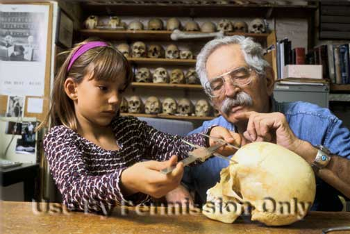 Dr. Charney shows a student how to measure a skull.